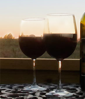 Wine Glasses at Sunset at Rocky Comfort Cabins